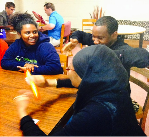 DSU honors students laugh amongst themselves at their game night