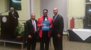 Willie B. Moore Jr. former football star receiving an Athletic award. (Photo Credit: Jasmine Saunders)
