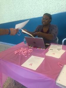 MAASM member Keda Dorisca handing out Breast Cancer information and wrist bands to passersby. (Photo: Asata Bamba)