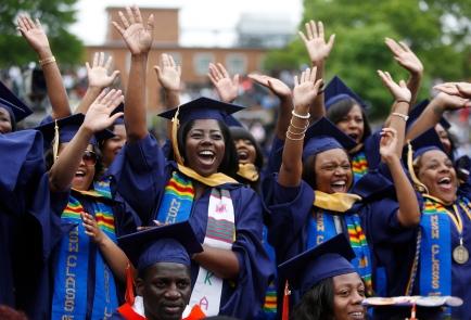 Graduates celebrate during 2014 graduation ceremonies at Howard University in Washington